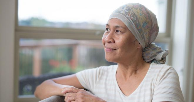Woman wearing headscarf with positive outlook after cancer